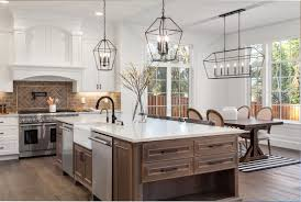 how to make a kitchen island with stock cabinets popular kitchen island trends designers are incorporating