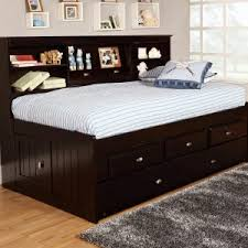 bedroom brown wood daybed trundle with white bedding