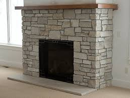 stone fireplaces pictures choosing a stone fireplace real stone or faux stone