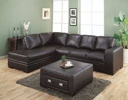 dark brown short sectional sofa combined green wall paint color