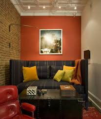 burnt orange walls family room industrial with yellow pillows