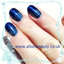 christmas nail art using gel ii midnight blue and magpie glitter
