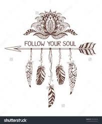beautiful background of decorative arrow with feathers in boho