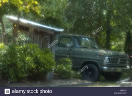 Old Ford Truck Van - outhouse old ford truck douglas lake east tennessee stock photo