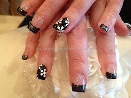 full set of acrylic nails with freehand flower nail art with black