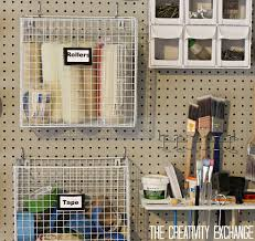 organizing the garage with diy pegboard storage wall pegboard diy garage pegboard storage wall using only 5 5 inches of depth the creativity exchange