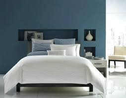 light blue laminate flooring purple and blue bedroom walls pink white flower bed cover light blue