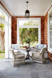 shingled covered patio with built in dining bench cottage deck