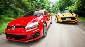 volkswagen gti racing 2015 volkswagen gti vs 2015 mini cooper s comparison test