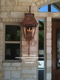Houston Outdoor Lighting Hill Country Style Home With Gas Lanterns Traditional Houston