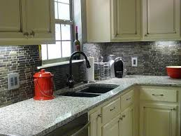 white cabinets with black granite backsplash and countertops