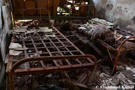 old metal frame hospital bed abandoned kansai