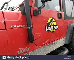 jeep wrangler logo red jeep wrangler with jurassic park logo inspired by the move