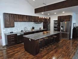Dark Kitchen Cabinets With Light Countertops - dark kitchen cabinet ideas orange shade pendant lights white