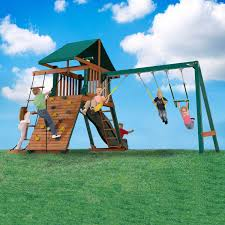 exterior backyard playset with striped canopy backyard fence