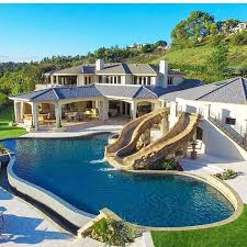 Backyard Pool With Slide - a luxurious swimming pool with two slides great backyard for a
