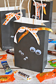 diy halloween treat bags and a halloween candy cookie bars recipe