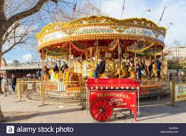 traditional galloping horses merry go southbank