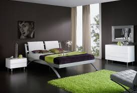 dazzling bedroom design with dark grey accent wall color and green