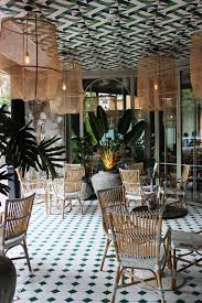 lush green restaurant decor with wooden dining table also plant