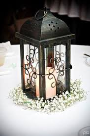 Lamp Centerpieces For Weddings by Lantern Centerpiece With Baby U0027s Breath Google Search Peach