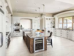 white kitchen cabinets tile floor light wood look kitchen flooring and mosaic tile backsplash