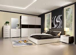 white wooden bed with black bedding set connected by white wooden bedroom white wooden bed with black bedding set connected by white wooden wardrobe next to