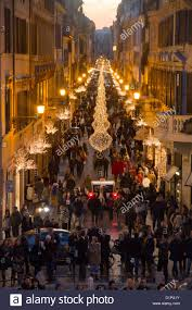 via condotti rome italy christmas decorations lights crowd of