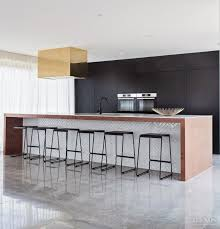 family kitchen with black wall cabinetry and wood framed island