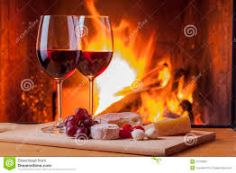 red wine and grapes at fireplace stock images image 33769924