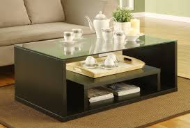 modern glass coffee table in minimalis house with stainless ice