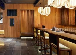 the restaurant bar counter and a row of bar chairs interior design