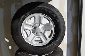 jeep wrangler sport rims jeep 16 inch oem wheels and tire package of 5 wheels tires oem
