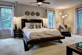 modern master bedroom illuminated with modern chandelier and