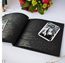 black guest book guest book with black and white photos photo booth guests write