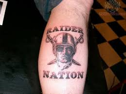 upper arm oakland raiders football helmet tattoo arm tattoo