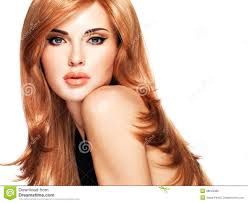hair style in long hair beautiful woman with long straight red hair in a black dress