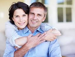 Why us  What our dating site can offer you   EliteSingles     Happy couple hugging on a porch