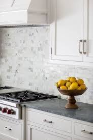 large white subway marble kitchen backsplash tile with black