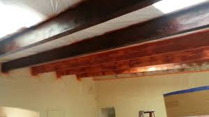How To Lighten Stained Wood by Finish Coat Of Stain On Wooden Beams In Living Room Youtube