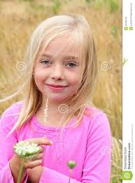 hair cute for 6 year old girls cute blond girl in the grass stock photo image of sitting