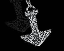 viking mjolnir pendant with tywaz rune and nordic ornaments