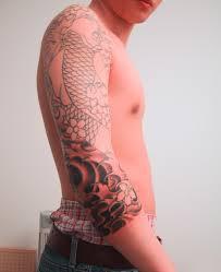 koi tattoo wrapped around the elbow dragon sleeve tattoos