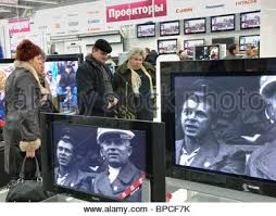 black friday flat screen shoppers with a flat screen television in their trolley on black