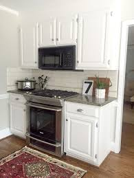 What Color Should I Paint My Kitchen With White Cabinets Our White Kitchen Cabinets Granite Emily A Clark