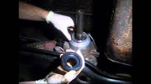 how to replace a rear transfer case output shaft seal on a jeep