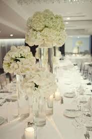 white flower arrangements white modern reception wedding flowers wedding decor wedding