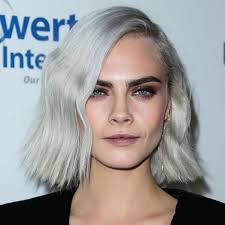 cara delevingne goes incognito after shaving her head in dramatic