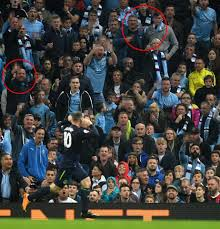 fan faces on a stick stunning coincidence as wayne rooney nets against manchester city in