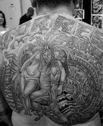 aztec warrior hold lady tattoo on full back tattooshunter com